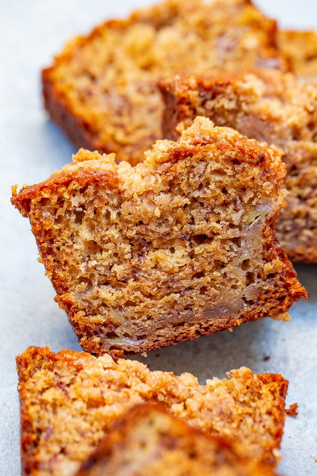 Cinnamon Sugar Streusel Banana Bread - Super SOFT tender banana bread that's impossible to resist!! The crispy, crumbly, streusel topping makes a good thing even BETTER!! An EASY no-mixer recipe and can be baked as one large loaf if you prefer!!