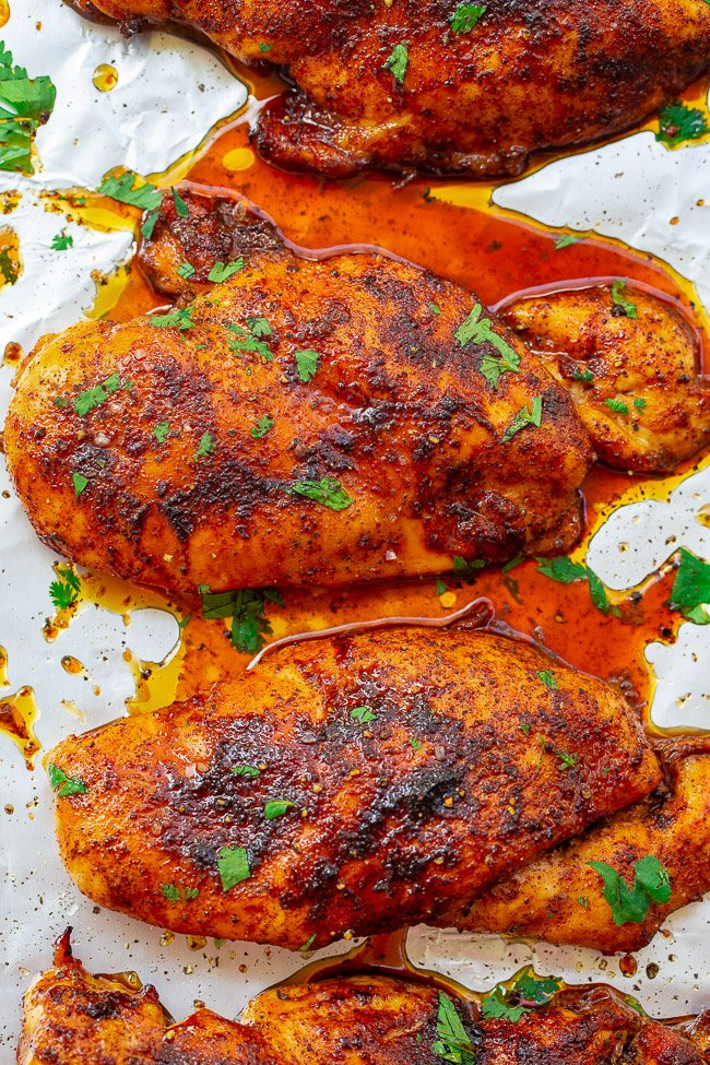 overhead view of two baked chicken breasts