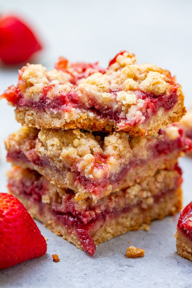 Strawberry Bars with Oatmeal Crumble Topping - These buttery bars are bursting with fresh strawberries!! Just 10 minutes of prep, so EASY because the crust and crumble are one and the same, and a crowd FAVORITE every time!!