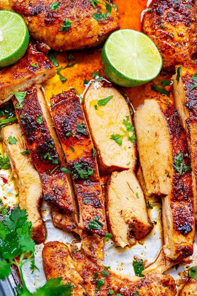 sliced lime and cilantro chicken breasts with lime halves