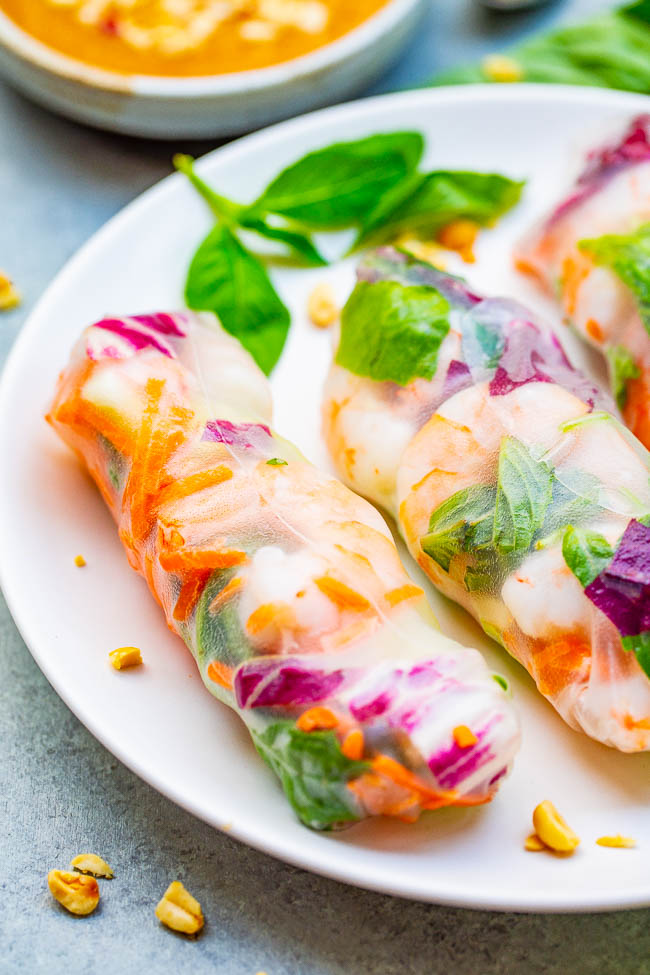 Fresh Spring Rolls with Peanut Sauce - Healthy rolls that taste just like your favorite Asian restaurant makes!! Fill them with your favorite veggies along with shrimp, chicken, or tofu - totally customizable! The homemade peanut sauce for dipping is AMAZING!!