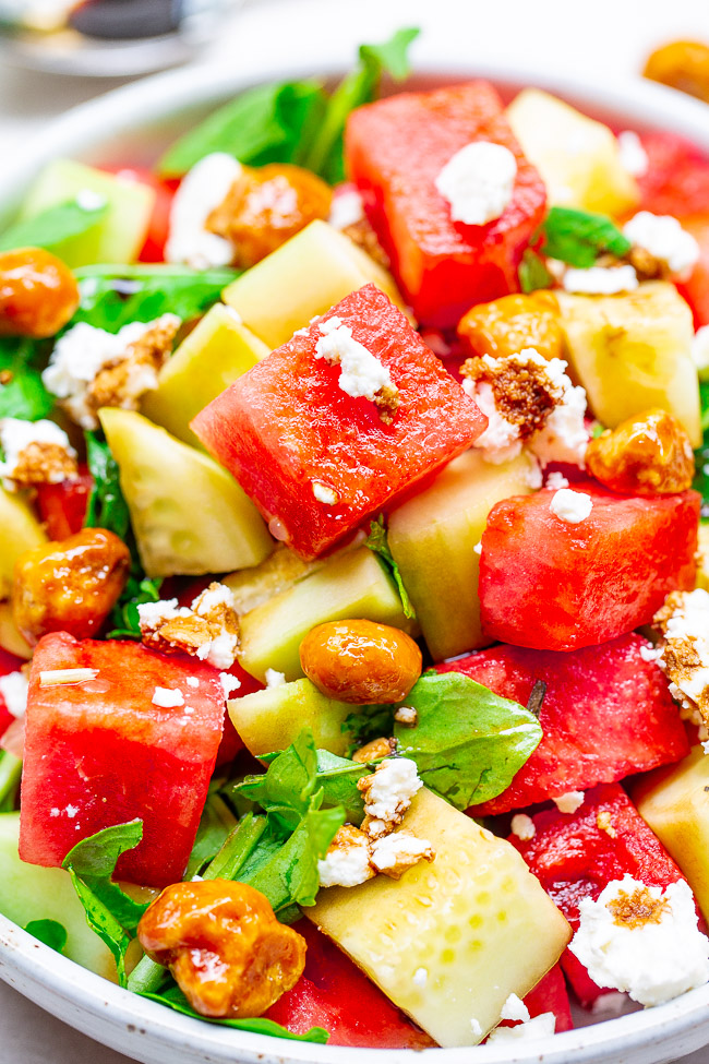 Balsamic Watermelon and Cucumber Salad - An EASY, healthy, and light salad with watermelon, cucumber, arugula, goat cheese, candied nuts, and drizzled with a homemade balsamic glaze!! A PERFECT summer salad for those days when it's too hot to cook!!