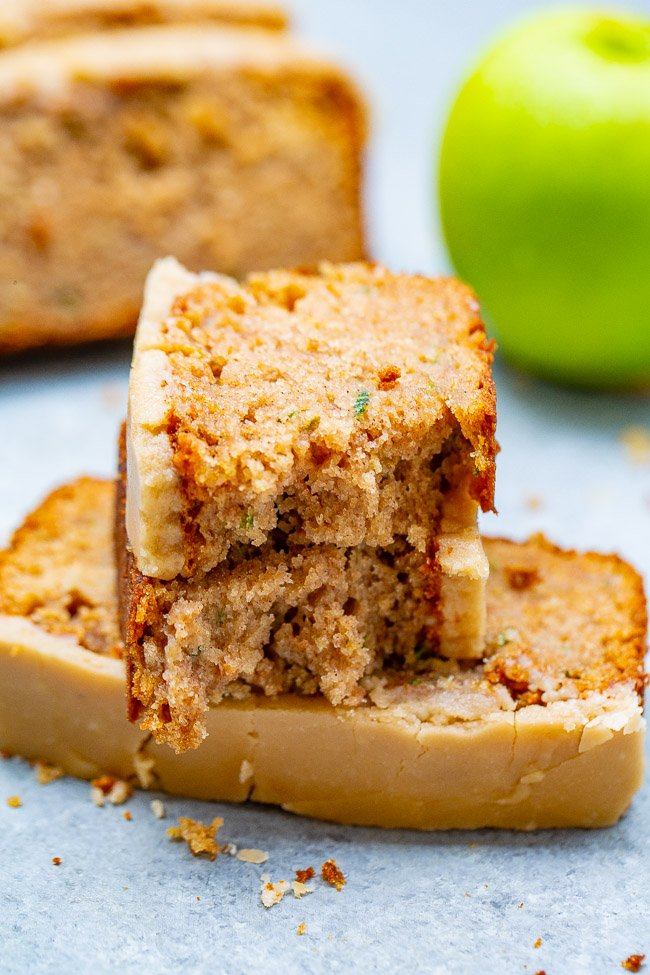 Apple Zucchini Bread with Brown Sugar Frosting -  Super soft, moist, and topped with the BEST frosting ever!!  One bowl, no mixer, EASY recipe for the best apple zucchini bread that everyone LOVES!!