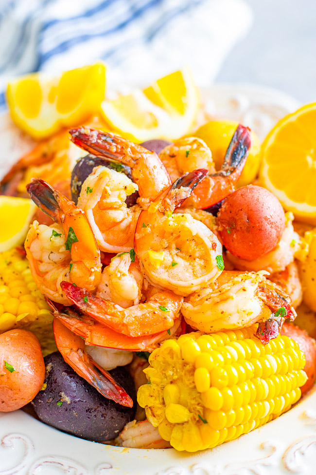 Shrimp Boil - Juicy and succulent large shrimp along with corn and potatoes, all drenched in the most heavenly horseradish butter!! There's the option to make your own homemade and ultra flavorful stock for the boil or use store bought stock as a shortcut! Either way, this is a finger lickin' amazing meal!!