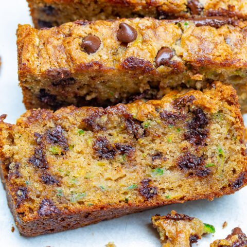 The Best Zucchini Bread - Super moist, tender, loaded with chocolate chips, and so EASY to make!! One bowl, no mixer, and THE BEST zucchini bread you'll ever try!!