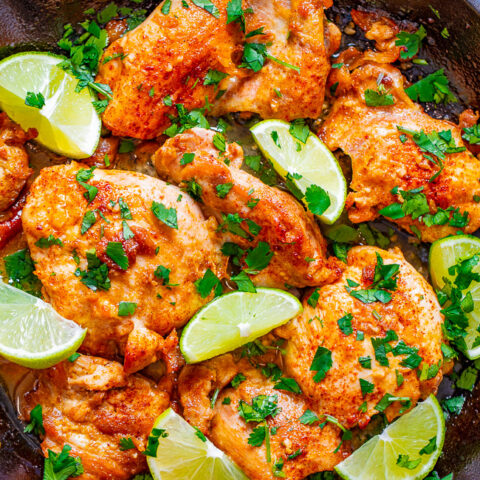 Skillet Lime Cilantro Chicken - EASY, juicy, tender chicken thighs with plenty of tangy lime and fresh cilantro!! Ready in 30 minutes, starts on the stove, and finishes in the oven! Just a handful of ingredients used and PERFECT for busy weeknights!!