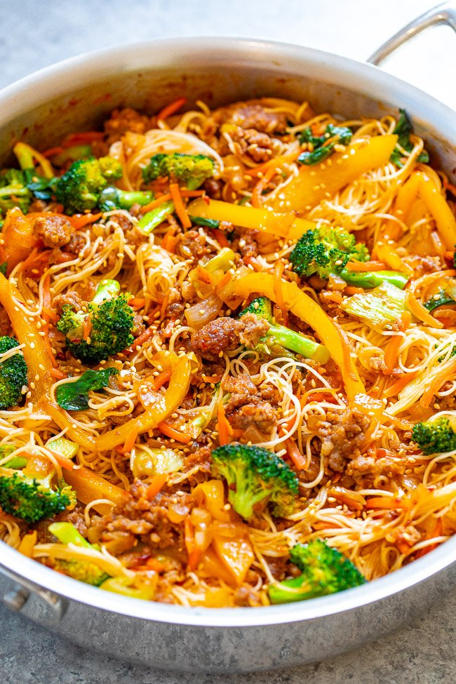 Asian Pork Noodle Stir Fry - An EASY comfort food stir fry that's ready in 20 minutes with so many textures and flavors in every bite!! Juicy pork, tender noodles, crisp-tender veggies in a bath of sesame oil, soy sauce, ginger, and chili garlic sauce if you want to turn up the heat!!