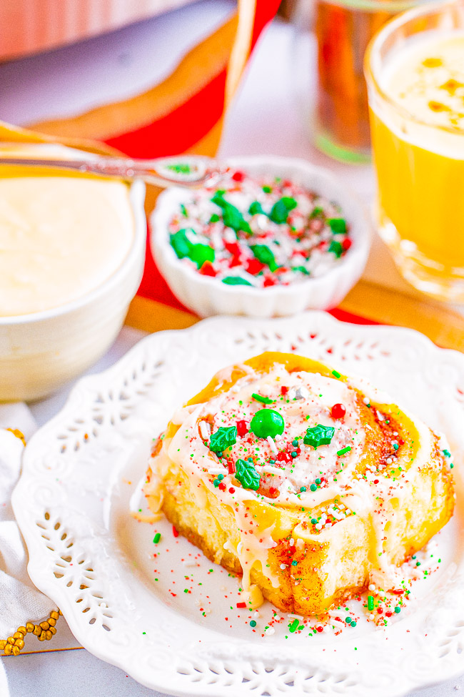 Overnight Eggnog Cinnamon Rolls - The SOFTEST and FLUFFIEST cinnamon rolls with an overnight MAKE-AHEAD option and eggnog frosting adds the perfect touch!! If you like Cinnabon rolls, you'll LOVE THESE!!