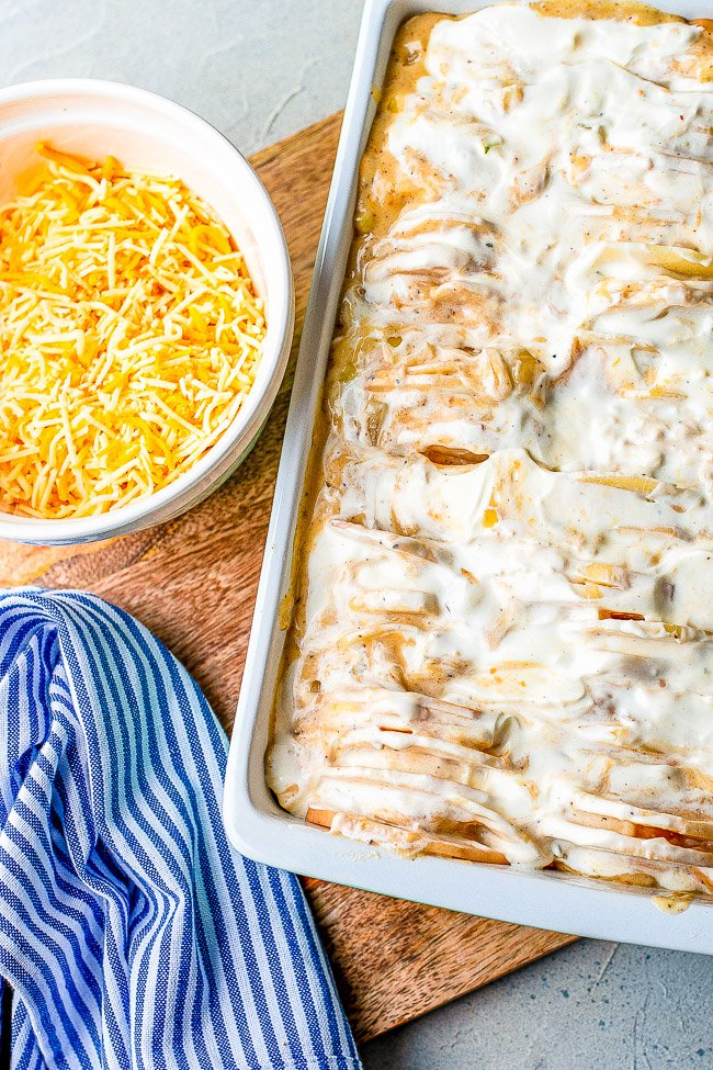 Three Cheese Scalloped Potatoes - These scalloped potatoes are EXTRA cheesy thanks to three cheeses used as well as super rich and CREAMY!! They're a perfect HOLIDAY SIDE DISH as well as family friendly weeknight COMFORT FOOD!