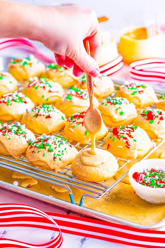 Eggnog Teacakes - Soft, buttery teacakes topped with a creamy eggnog glaze are a Christmas treat that everyone will love!! EASY to make, not at all dry, and great for cookie exchanges or hostess gifts!!