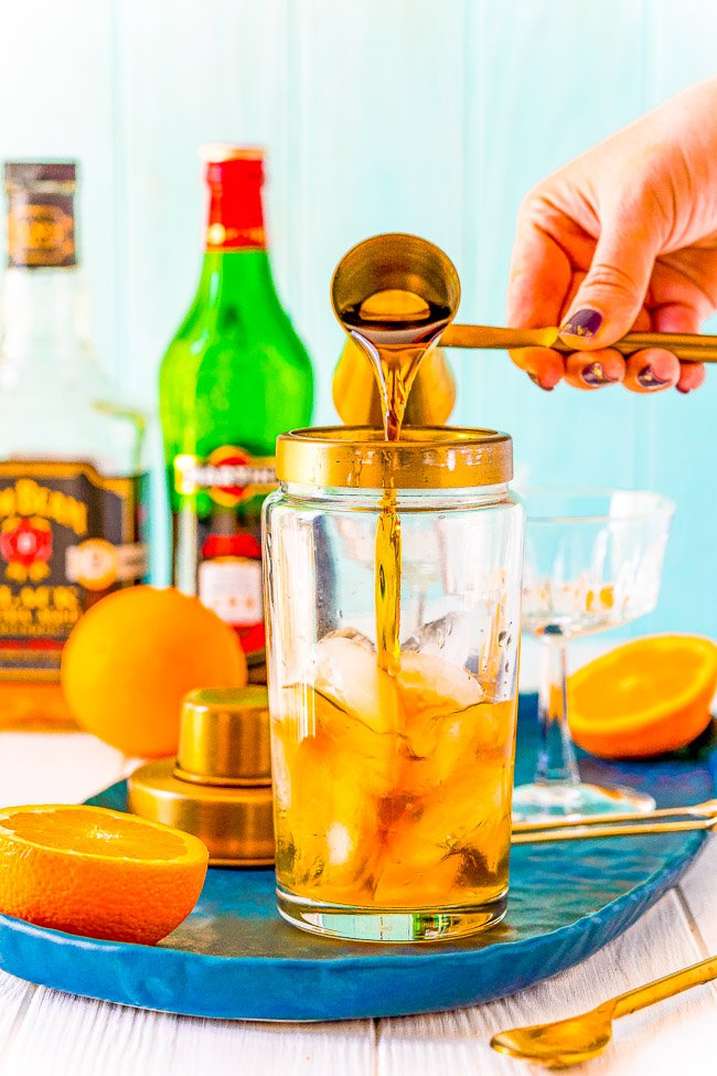 Manhattan Cocktail - This classic bourbon cocktail is made with vermouth, Angostura bitters, and orange peel for a sophisticated and easy drink everyone should know how to make!