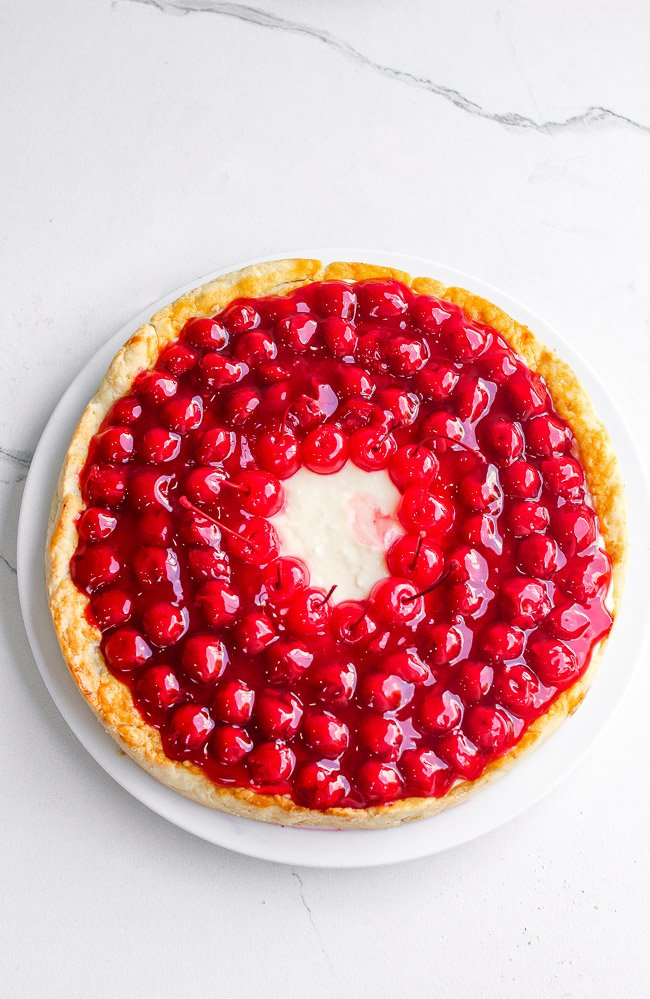 Cherry Cream Pie - An old-fashioned pie with homemade scratch crust topped with NO-BAKE layers of sweetened cream cheese along with juicy cherry pie filling!! If you like cherry pie, you're going to LOVE this amped up version!!