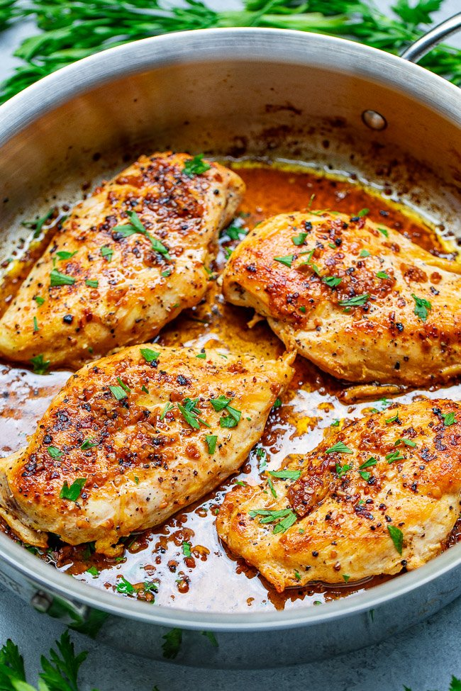 Garlic Butter Chicken - Tender, juicy chicken bathed in a rich garlic butter sauce with a splash of wine for extra flavor!! This EASY stovetop chicken recipe is ready in 15 minutes and will become a family FAVORITE!!