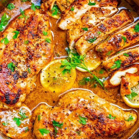 Lemon Butter Dijon Skillet Chicken - Tender, juicy chicken with a scrumptious sauce made with lemon butter, Dijon mustard, and a splash of wine for extra flavor!! This EASY stovetop chicken recipe is ready in 15 minutes and will become a family dinner FAVORITE!!