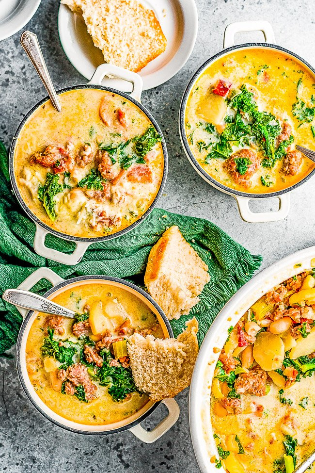 Loaded Zuppa Toscana - This COPYCAT version of the Olive Garden classic can be made either on the STOVETOP, INSTANT POT, or SLOW COOKER!! A comforting classic Tuscan soup that's loaded with bacon, sausage, potatoes, Parmesan, cream, and more!!