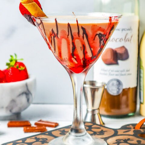 Chocolate Covered Strawberry Martini - An indulgent chocolate martini that's perfect for Valentine's Day, anniversaries, or a girls-night-in! Plenty of chocolate flavor in this festive, fun, and easy martini!