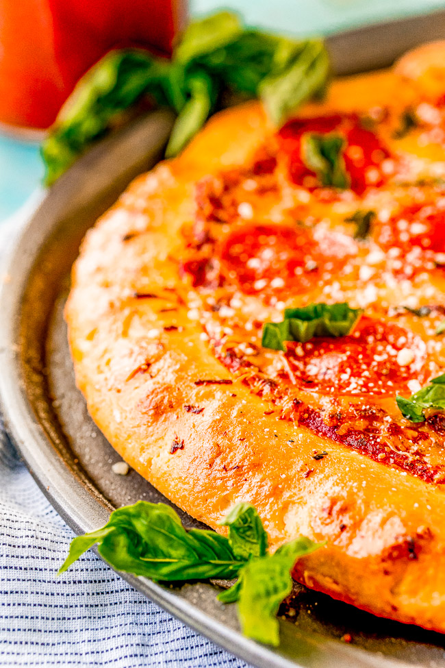 2-Ingredient Pizza Dough - The EASIEST homemade pizza dough you'll ever make with just two ingredients!! NO yeast, NO kneading, and NO need to wait for it to rise! Homemade pizza just became your new reality!!