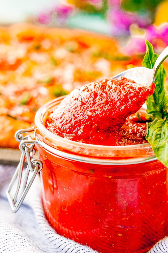 Easy Pizza Sauce Recipe — A no-cook, no-blender recipe for homemade pizza sauce that's ready in five minutes!! Simply whisk the ingredients together and get ready to enjoy pizza sauce that's BURSTING with flavor! Once you see how EASY this is, you'll never need the store bought kind again!!