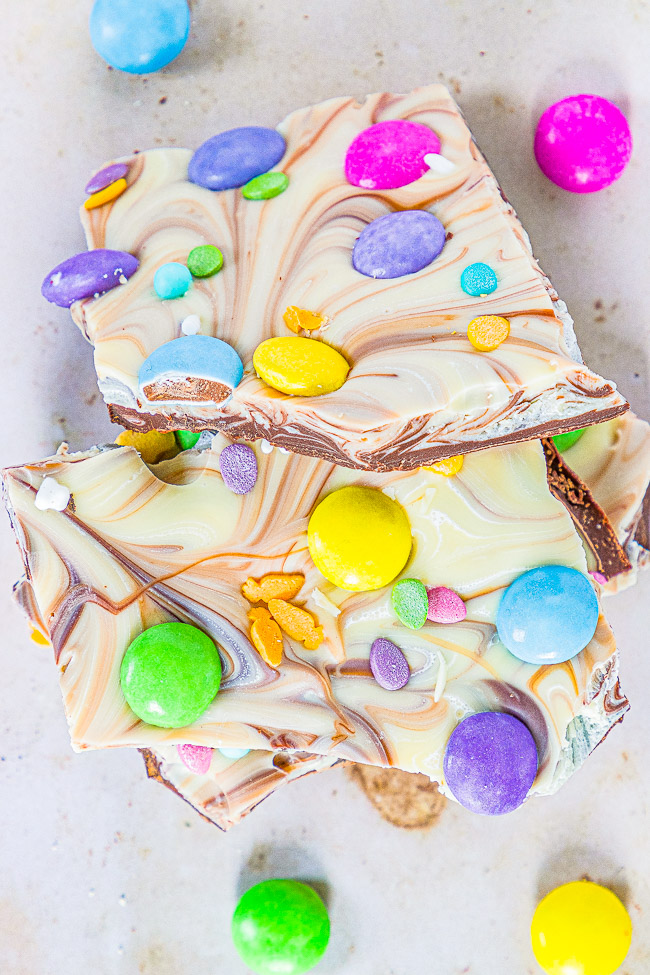 Easter Chocolate Bark - A mixture of milk and white chocolate swirled together and topped with M&Ms and sprinkles!! Such a FAST, EASY, NO-BAKE, and MAKE-AHEAD treat that's perfect for Easter, springtime, or Mother's Day!!