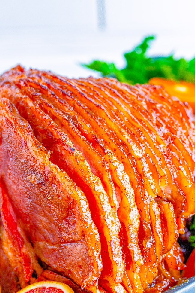 Honey Baked Ham - Spiral baked honey ham that's SO EASY you really can't mess it up! The sweetness from the honey works perfectly with the saltiness of the ham. This ham is similar to the honey baked ham everyone loves to purchase but so much less expensive! Perfect for HOLIDAY MEALS and family dinners!