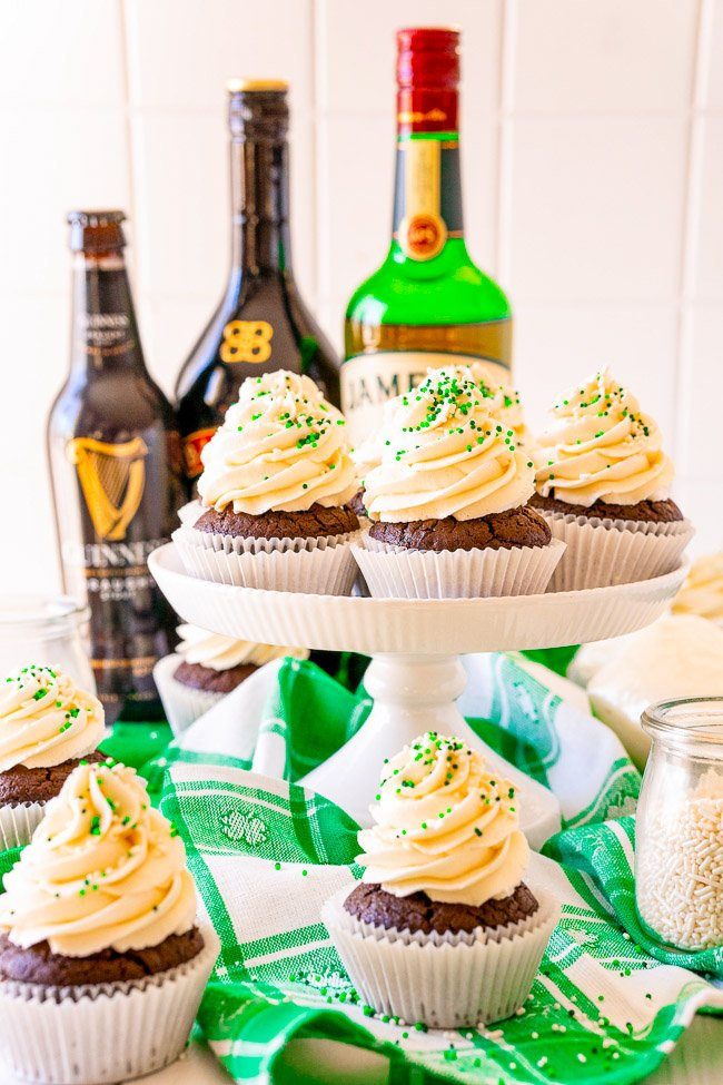 Irish Chocolate Cupcakes - A tender chocolate cupcake made from scratch with batter that's spiked with Guinness, along with a hint of Jameson Irish whiskey in the chocolate ganache filling, and frosted with a silky smooth Baileys buttercream frosting!! Not too boozy and not too sweet! Makes a smaller batch of 12 and PERFECT for St. Patrick's Day!!