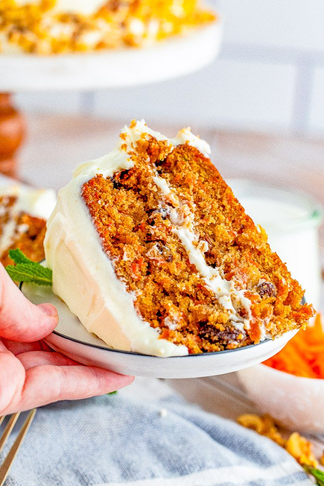 Layered Carrot Cake with Cream Cheese Frosting - A tender and moist classic two-layer carrot cake with tangy-sweet cream cheese frosting! For anyone who loves carrot cake, this cake looks and tastes so impressive but is EASY to make! Perfect for Easter, springtime, or any carrot cake cravings you have!