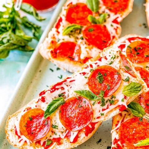 French Bread Pizza - This FAST and EASY pizza recipe incorporates a French bread crust. This handy shortcut saves you time on busy weeknights to make home-baked pizza a reality. Pizza is always a family FAVORITE and this thick and chewy variety will be a big hit!