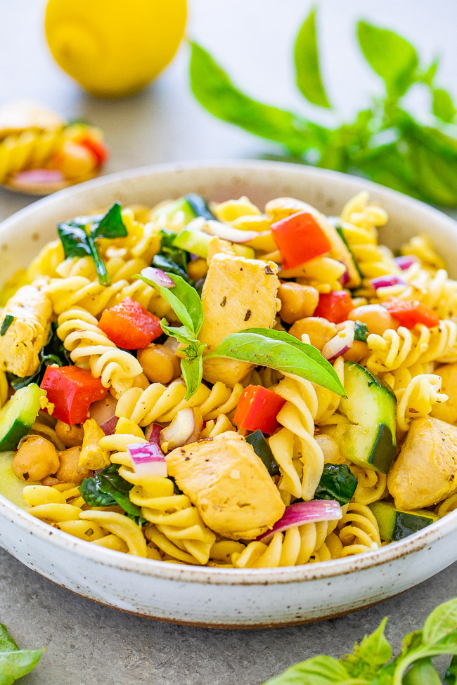 Mediterranean Lemon Chicken Pasta Salad - This chicken pasta salad is loaded with flavor, ready in minutes, and showcases Mediterranean-inspired ingredients! It's perfect for summer potlucks and barbecues (no mayo!) and feeds a crowd. Or make it as an EASY family dinner with planned leftovers!