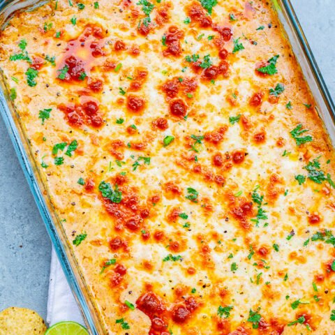 Mexican Baked Cheesy Street Corn Dip - A hot corn dip reminiscent of Mexican street corn!! Creamy, cheesy, spiked with lime juice, chili powder, and a serrano chile or jalapeno for a touch of heat! SO EASY and ready in 20 minutes!! Perfect for parties, potlucks, tailgating, or your next FIESTA!!