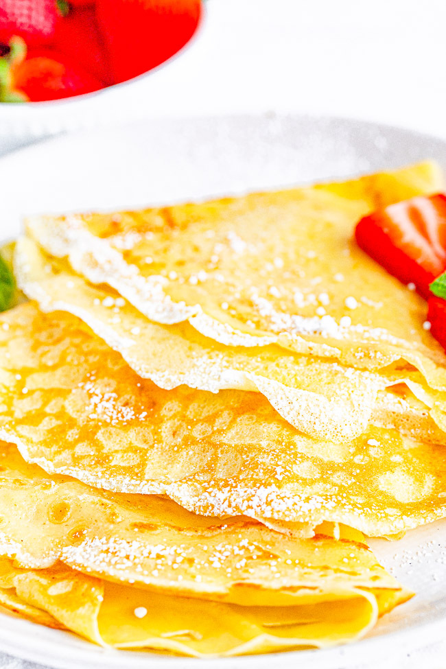 Classic Crepes — This basic crepe recipe produces tender, thin, delicate, buttery crepes that are wonderful with most any kind of filling from sweet to savory! Learn to make classic French crepes at home with just 6 COMMON ingredients! FAST, EASY, and NO special pans required!