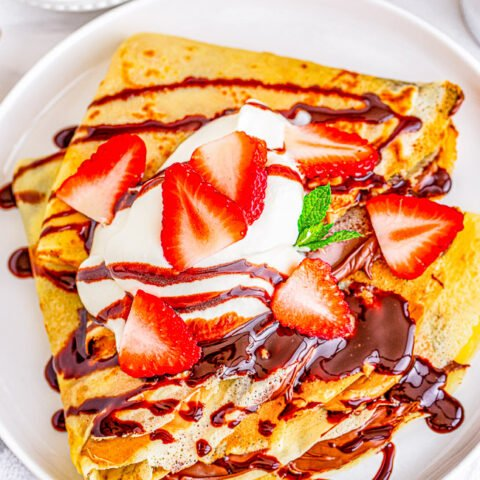 Classic Crepes - Tender, thin, delicate, buttery, and are wonderful with most any kind of filling from sweet to savory! Learn to make classic French crepes at home with just 6 COMMON ingredients! FAST, EASY, and NO special pans required!