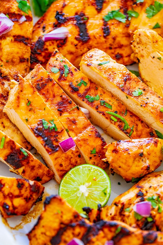 Grilled Lime Cilantro Chicken with Guacamole - EASY, ready minutes, and the chicken is tender, juicy, and full of Mexican-inspired flavors!! Chunky guacamole pairs PERFECTLY with this grilled chicken! A family favorite recipe everyone loves!!