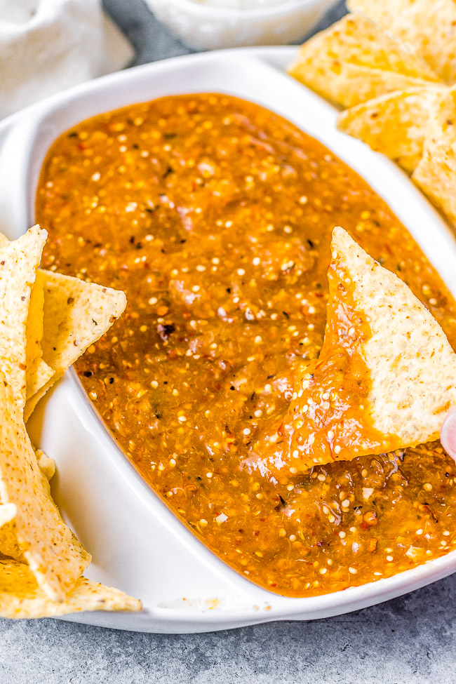 Pineapple Chipotle Salsa - A sweet and spicy salsa with a lovely smokiness from pineapple, tomatillo, onion, and garlic that are blistered under broiler and then blended with chipotle peppers! PERFECT over tacos, with chips, or as a great addition to any Mexican-inspired meal!