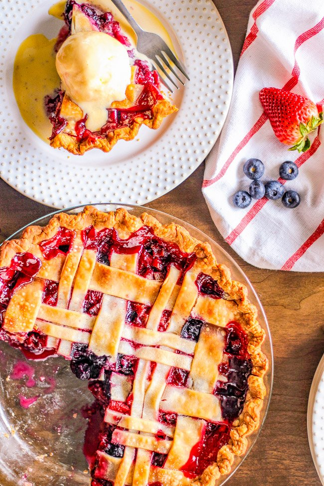 Rhubarb Berry Pie – A classic, EASY, fruit pie made with rhubarb, strawberries, and blueberries! Sweet yet a bit tart, very juicy, and a PERFECT spring or summer dessert! Use a store bought pie crust to save time!