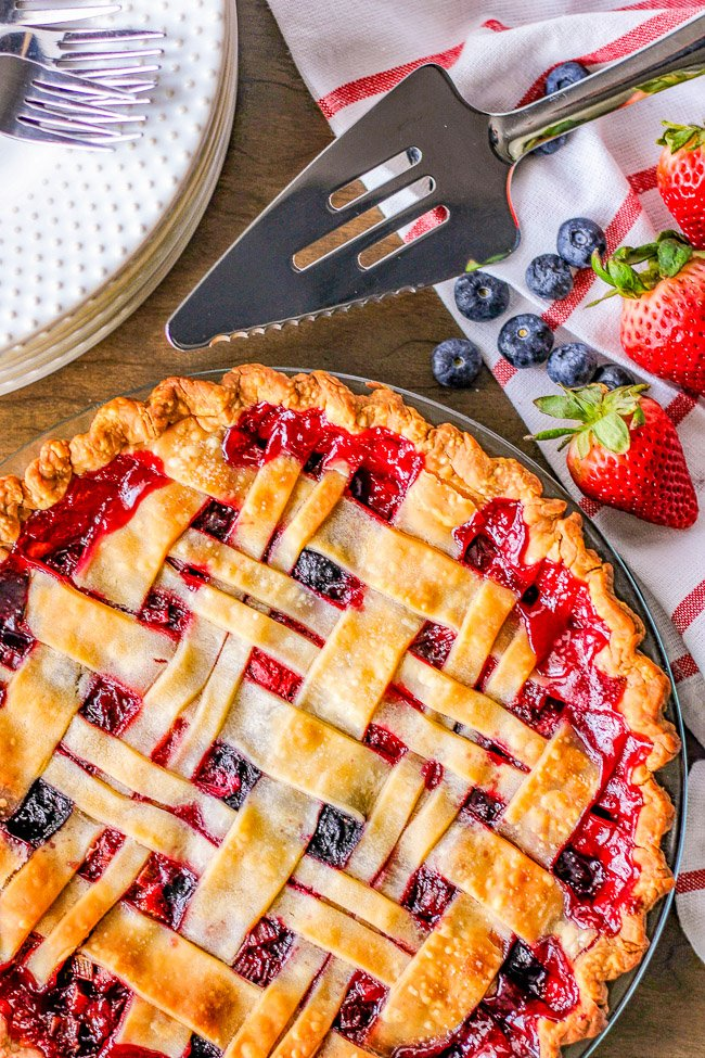 Rhubarb Berry Pie - A classic, EASY, fruit pie made with rhubarb, strawberries, and blueberries! Sweet yet a bit tart, very juicy, and a PERFECT spring or summer dessert! Use a store bought pie crust to save time!