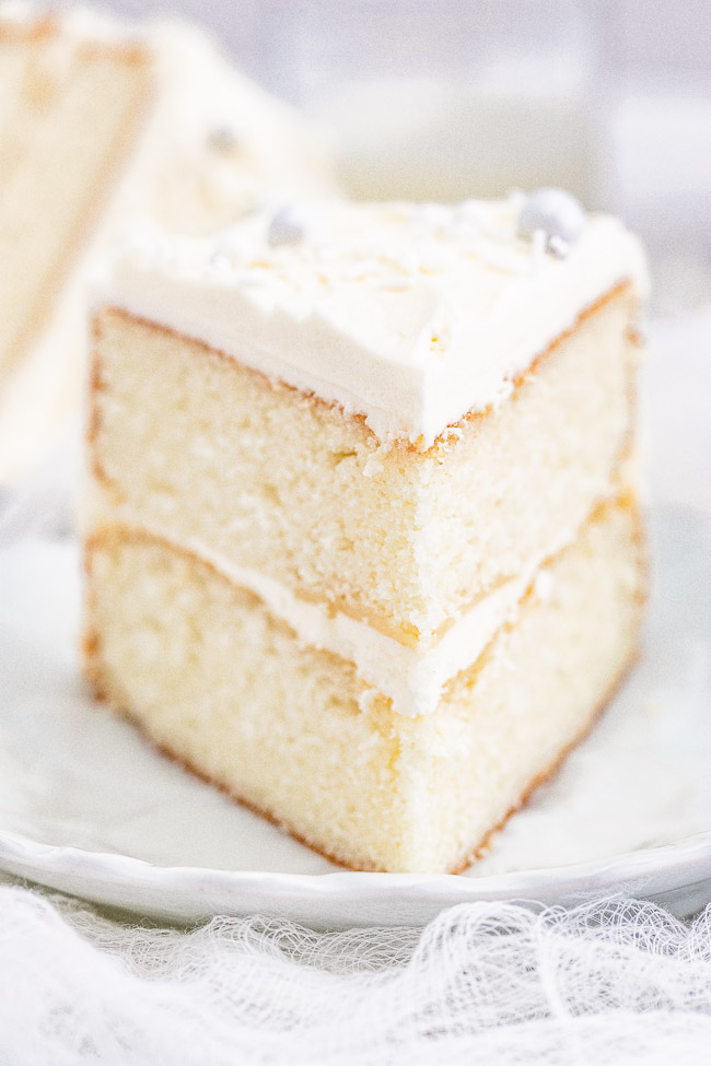White Layer Cake - A classic, white, two-layer cake recipe for cake with a light texture that's complemented by super light and fluffy buttercream that's not too sweet! Learn how to make THE BEST white layer cake that's fancy enough to serve at your most special celebrations and events!