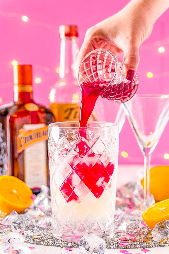 Cosmopolitan - This classic cocktail is made with vodka, orange liqueur, lemon juice, and cranberry juice. It's flirty and flavorful yet refined and simple. Tart cranberry juice blends with fresh lemon juice to smooth out the vodka and enhance the triple sec for a balance and refreshing cocktail perfect for sipping!