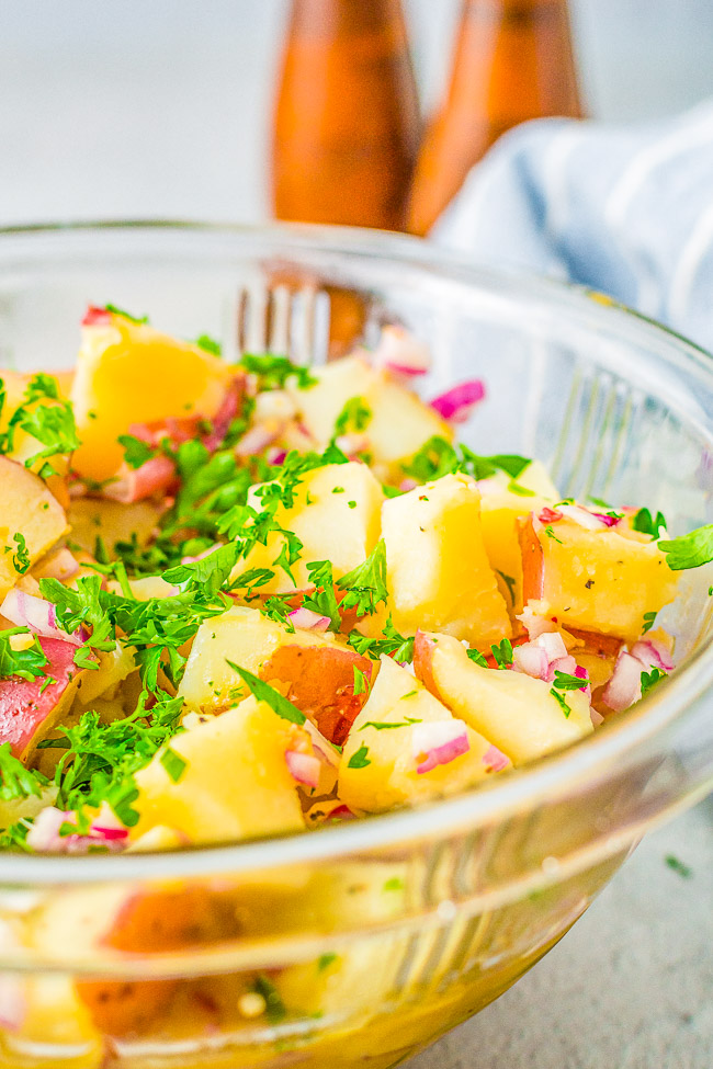 German Potato Salad - A classic potato salad made with tender red potatoes, bacon, onions, and a tangy dressing! This no-mayo potato salad is a family favorite side dish that's perfect for parties, picnics, and potlucks!!