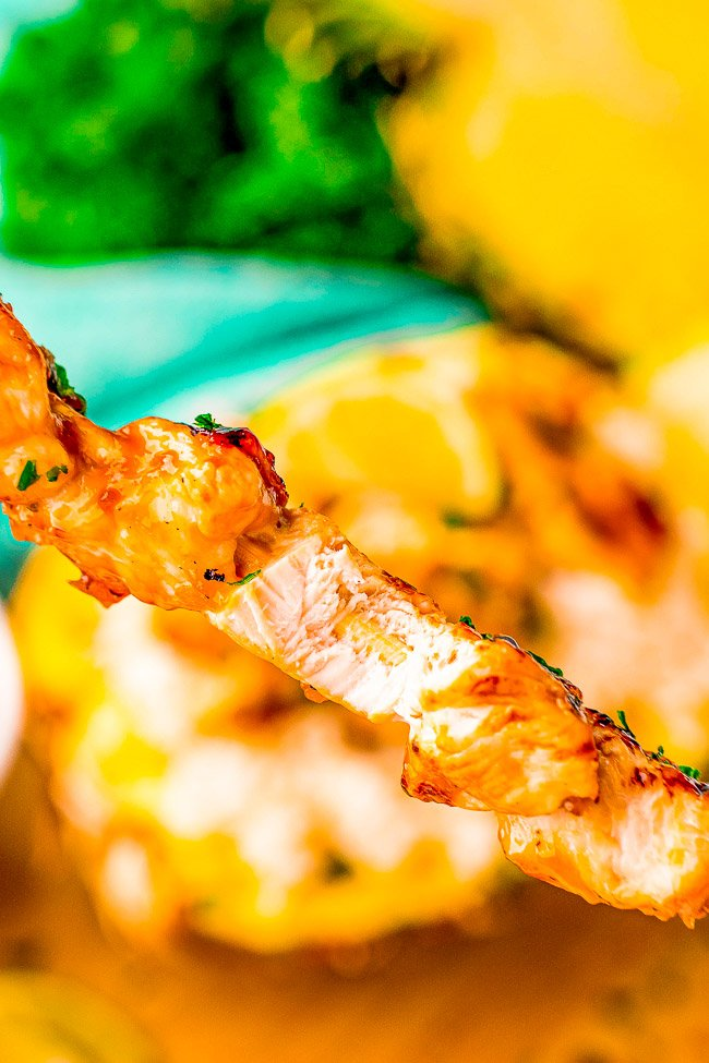 Pineapple Teriyaki Chicken Skewers - Fast, easy, and loaded with sweet-and-savory pineapple teriyaki flavor! Made with just a handful of basic ingredients, these grilled chicken skewers will be a family FAVORITE! Serve with coconut rice in a pineapple for a showstopping presentation!