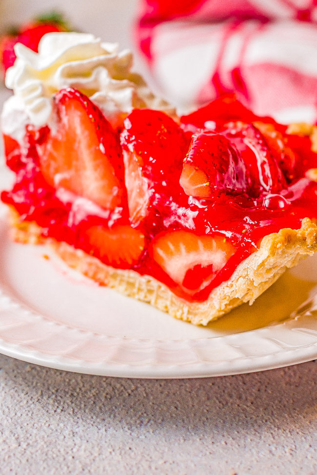 Strawberry Pie – This EASY strawberry pie is bursting with juicy, fresh strawberries and covered in a delicious glaze! Use a homemade flaky crust OR a refrigerated store bought crust for this amazing pie that everyone LOVES! Only SIX main ingredients!