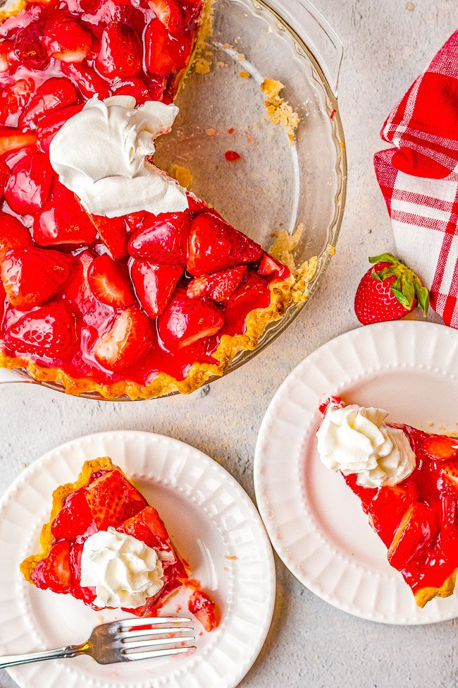 Fresh Strawberry Pie – This EASY strawberry pie is bursting with juicy, fresh strawberries and covered in a delicious glaze! Use a homemade flaky crust OR a refrigerated store bought crust for this amazing pie that everyone LOVES! Only SIX main ingredients!