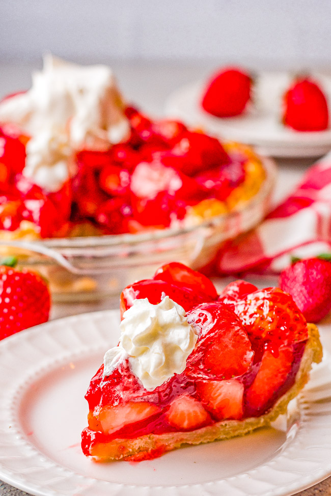 Fresh Strawberry Pie - This EASY strawberry pie is bursting with juicy, fresh strawberries and covered in a delicious glaze! Use a homemade flaky crust OR a refrigerated store bought crust for this amazing pie that everyone LOVES! Only SIX main ingredients!