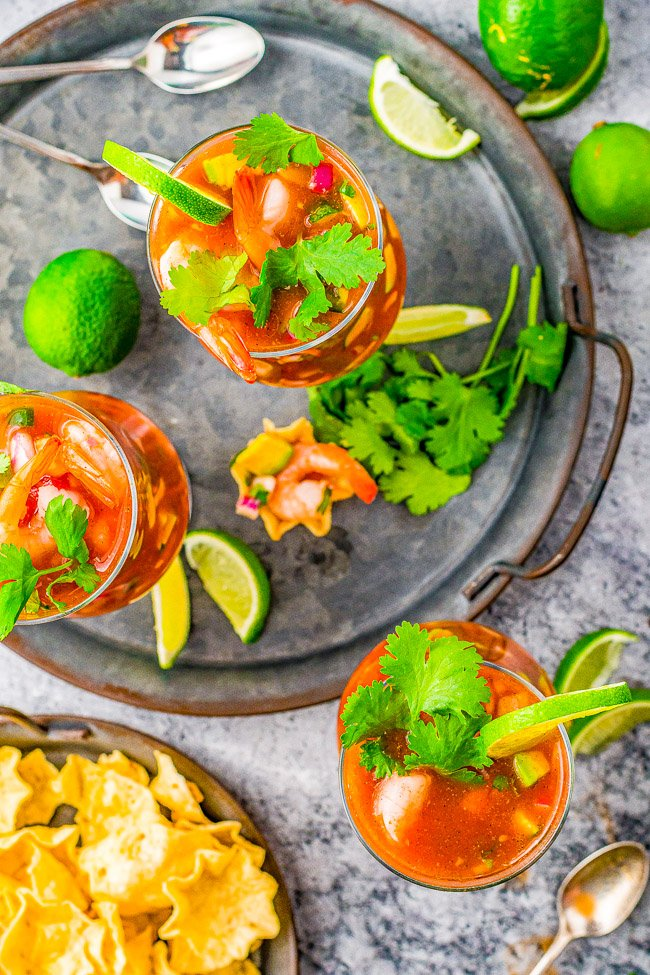 Mexican Shrimp Cocktail - Chilled shrimp, tomatoes, cucumber, onion, jalapeno, creamy avocado, and more are combined in a tomato-based sauce, along with a bit of Mexican hot sauce for some kick! Perfect for entertaining or as a no-cook lunch, snack, or dinner - especially when it's too hot to cook!