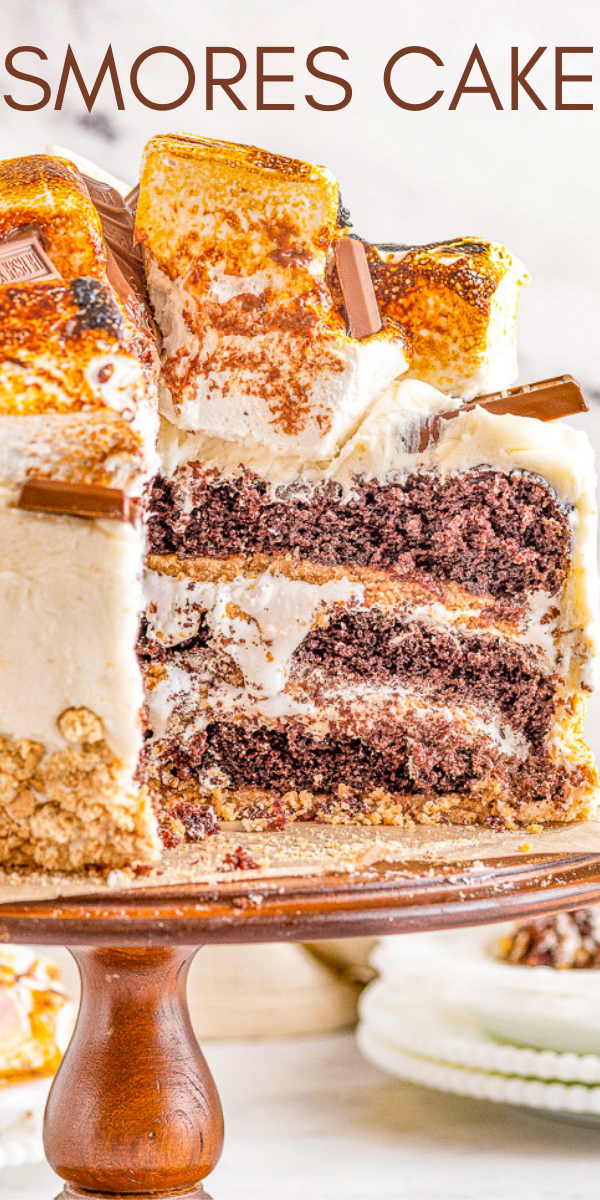 Smores Cake - A three layer showstopping cake that everyone will ADORE! Moist and tender layers of chocolate cake along with crunchy graham cracker crusts, sweet marshmallow buttercream frosting, toasted marshmallows, and chocolate bars for a true smores experience! So many AMAZING textures and flavors in this rich and decadent smores cake! My very detailed post walks you through making this cake in extreme detail so it's easy enough to master even for average bakers!