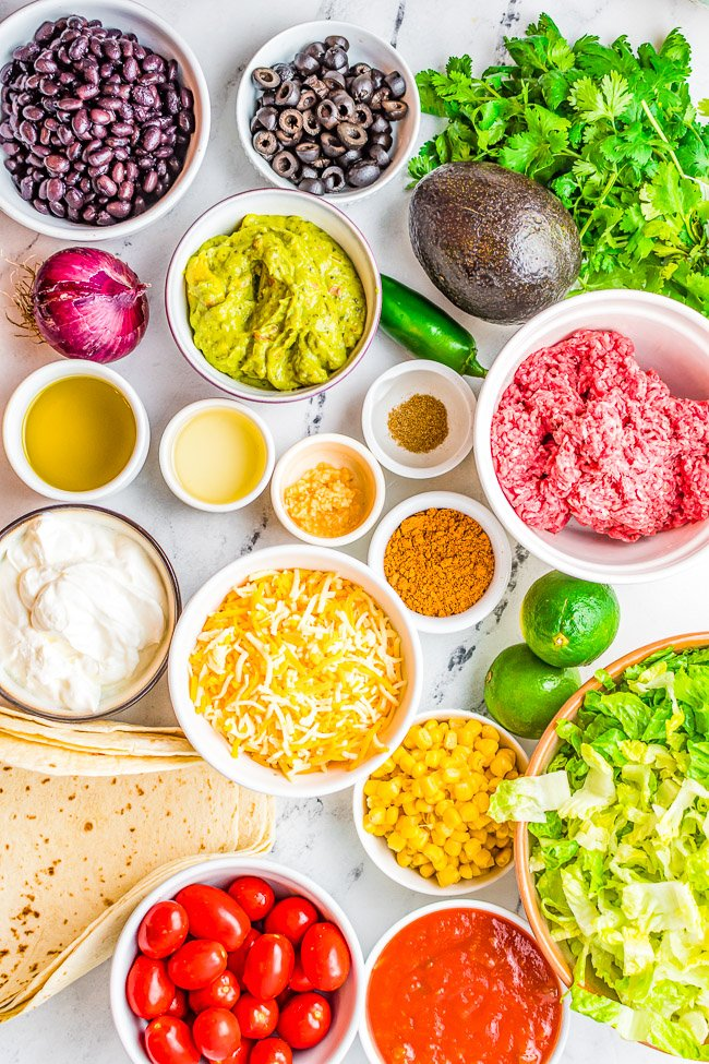 Beef Taco Salad Bowls – Making homemade taco salad bowls is so easy and they're perfect for holding this family-favorite taco salad including seasoned ground beef, black beans, cheese and more! Everything is topped with a creamy lime-cilantro dressing that'll have everyone finishing their salad!