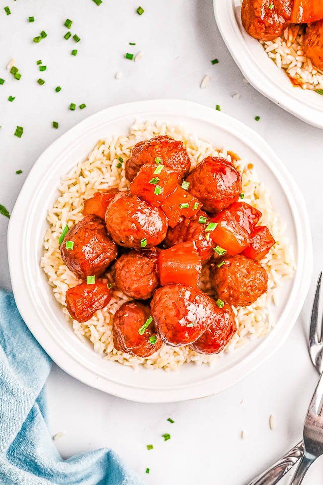 Slow Cooker Hawaiian Meatballs - The EASIEST meatball recipe that's sure to be a hit at parties and events! Or turn this into a no-fuss weeknight meal and serve these pineapple-infused Hawaiian meatballs over rice! Made with only 6 ingredients so you can just set your slow cooker and let it do all the work!
