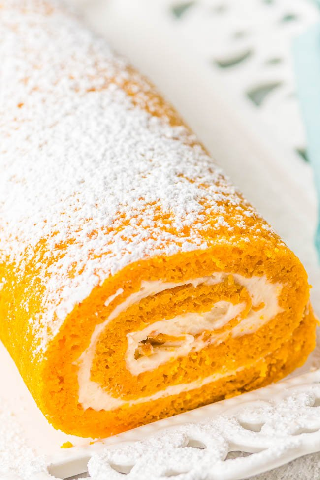 Pumpkin Roll - With my EASY pumpkin roll recipe and clear specific directions, you're going to be a pumpkin roll pro! No dish towel required to roll up my classic pumpkin roll cake that's full of rich pumpkin spice flavor and tangy cream cheese frosting! A fall favorite that all pumpkin fans will just ADORE! Freezes well and makes a great hostess gift!