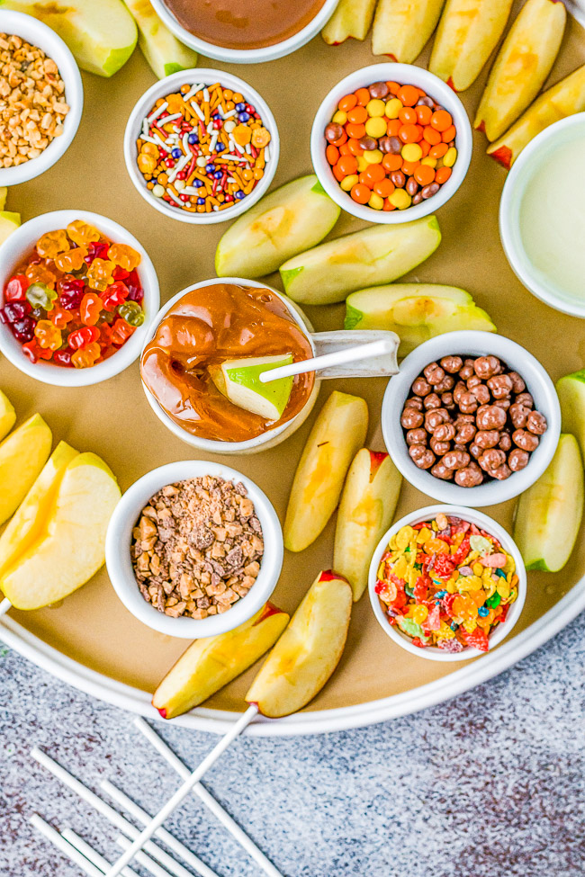 Caramel Apple Board - It's caramel apple season and this caramel apple board is a FUN and festive quintessential fall treat! EASY to prep and it's a wonderful family family-friendly activity for kids and adults alike!