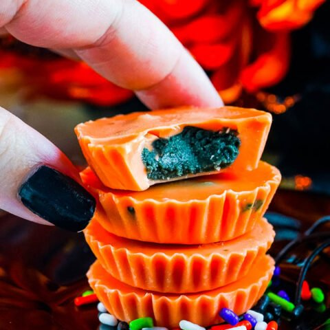 Halloween Peanut Butter Cups - Learn how to make peanut butter cups with this EASY FIVE INGREDIENT RECIPE! With festive Halloween colors, they're sure to be a hit with everyone from kids to adults alike! They keep perfectly for weeks so feel free to make them in advance and pass them out at your Halloween parties and festivities!