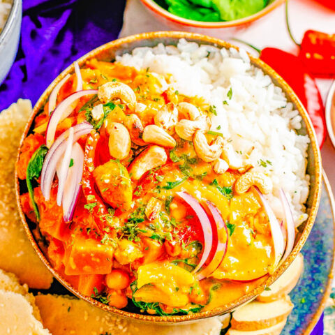 Thai Pumpkin Chickpea Coconut Curry - An EASY curry that's ready in 30 minutes! Tender fresh pumpkin, chickpeas, bell peppers, spinach, and more all bathed in the most aromatic Thai-inspired coconut milk broth! If you love Thai food, skip the restaurant and make this better-than-takeout curry at home!